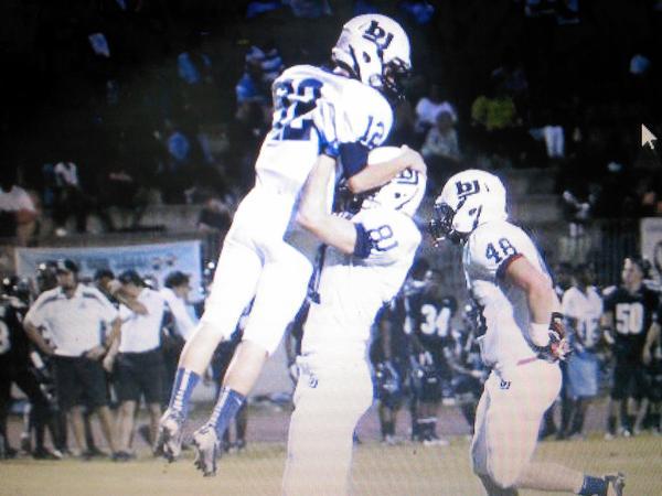 Seth Parker (left) and Mitch Davis celebrate a big play
