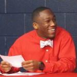 Drew Davis signing a football scholarship to Western Kentucky
