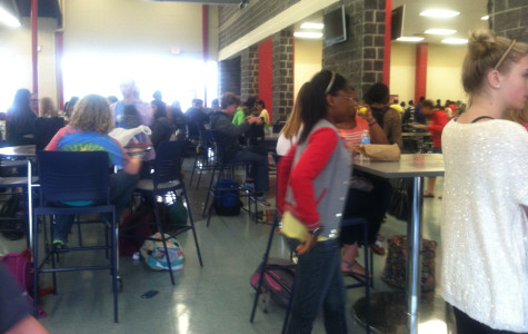 Students enjoy the new tables in the lunch room.