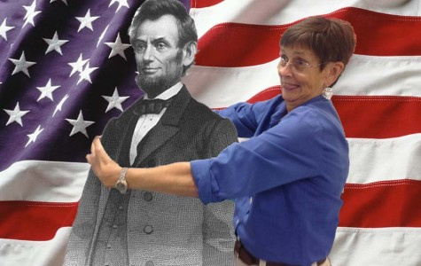 Mrs. Newell hugging Abraham Lincoln in front of the American flag