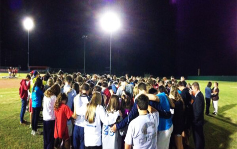 All of the students gathered on the baseball field
