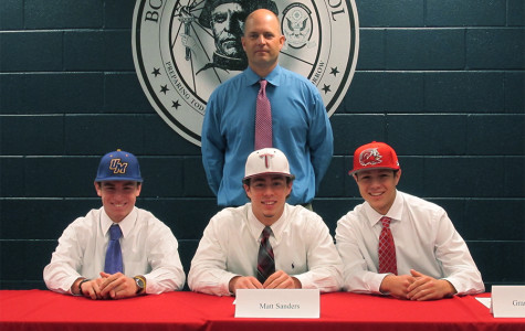 Baseball Players Sign the Dotted Line