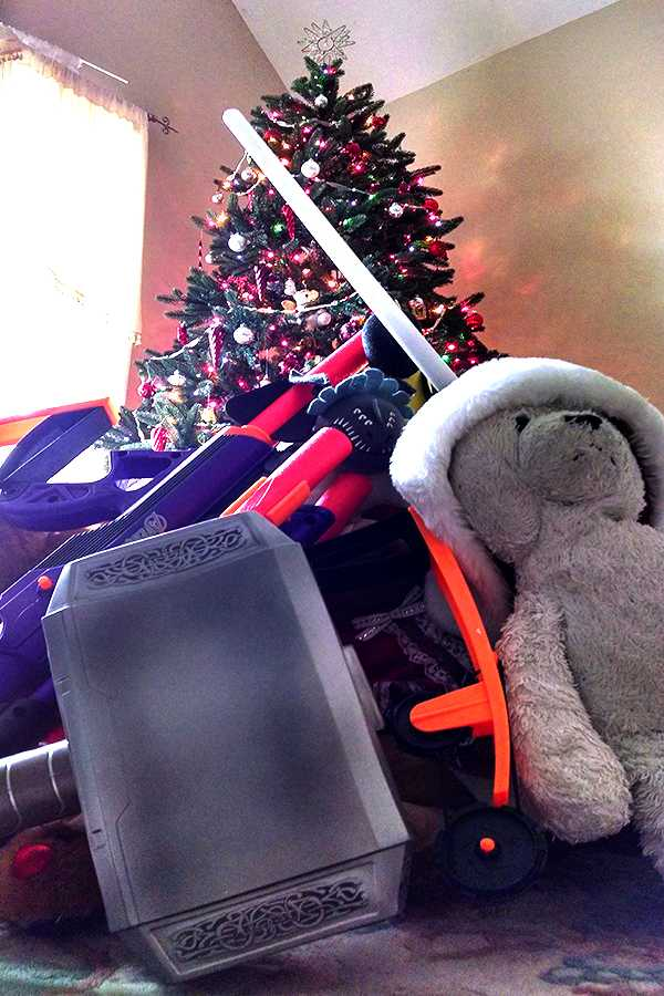 A pile of toys under a christmas tree