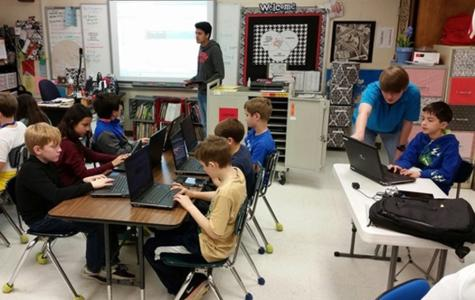 Computer Science students teaching an Hour of Code at West Madison.