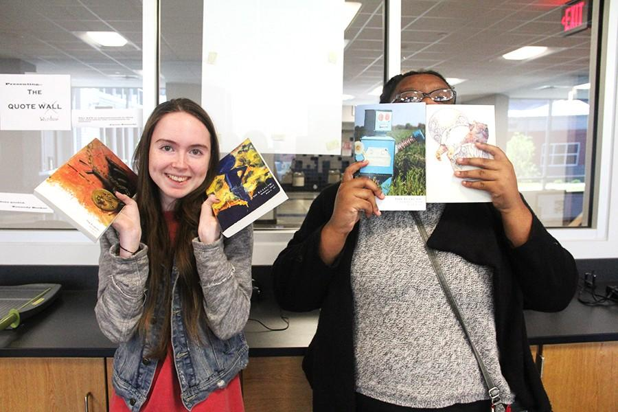 The Eclectic editors, Kayla Carden (Left) and Alyssa Kennedy (Right), with past literary magazines.