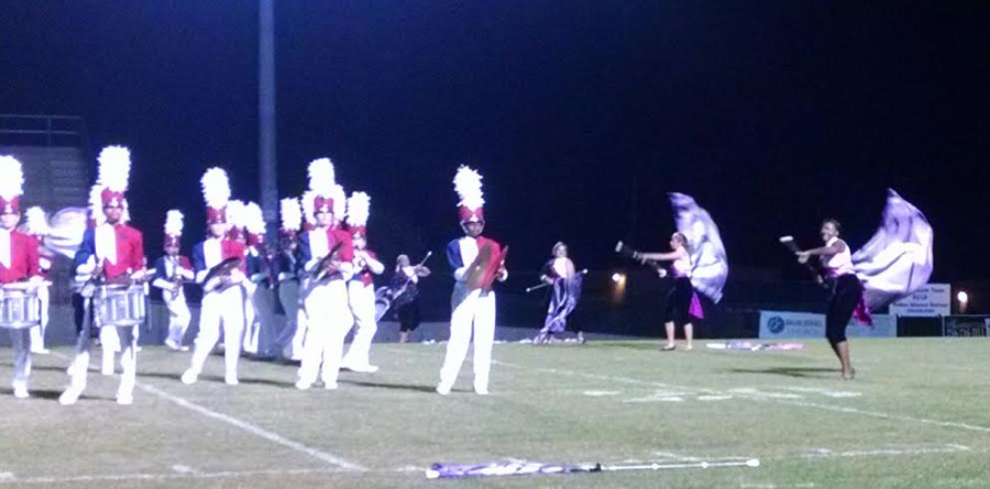 Competition band members perform Chandelier while the color guard team dances along.