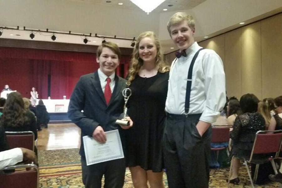 Student Tech Directors (From left to right) Kenji Tyler, Sierra Anderson, and Ryan Knowling with their award for