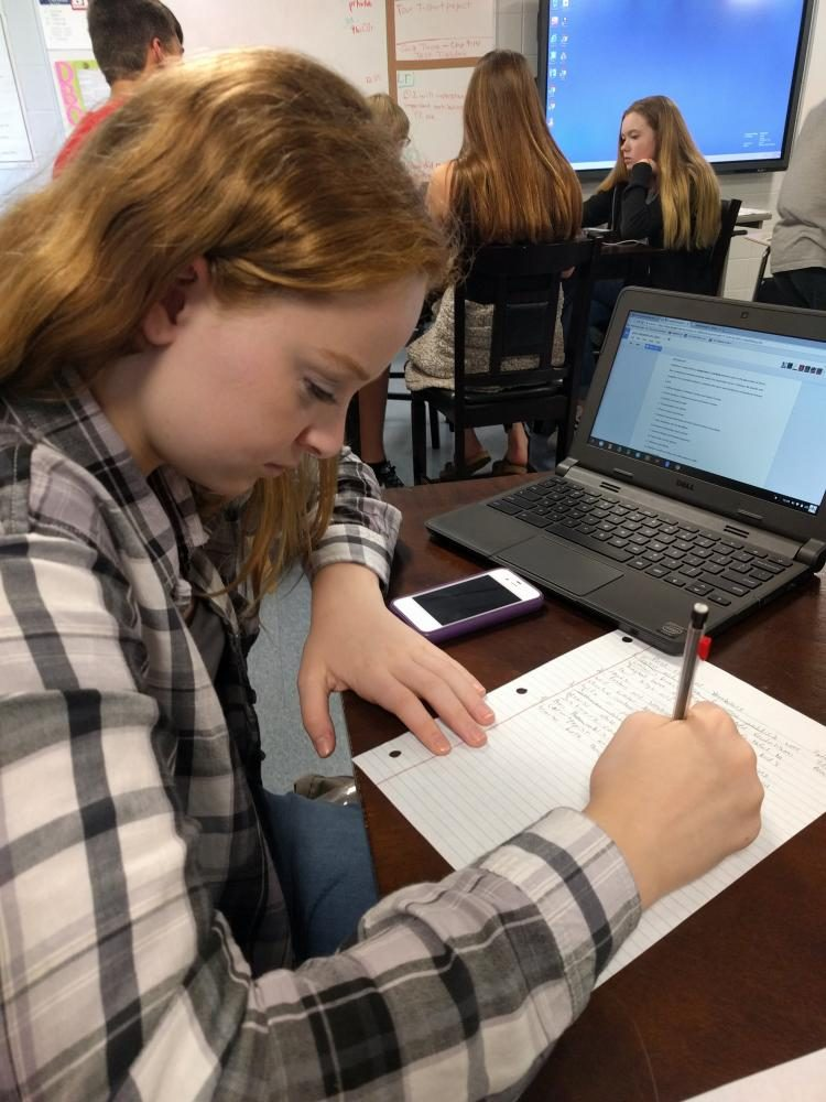 A student works on AP classwork during class.