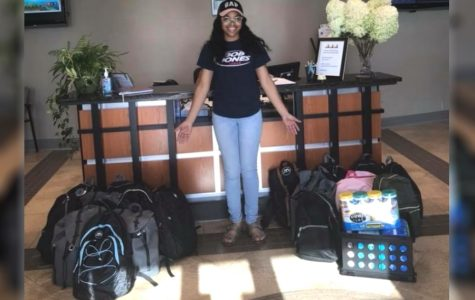 Bob Jones Senior Madison Carmouche poses at MCS Central Office with donations.