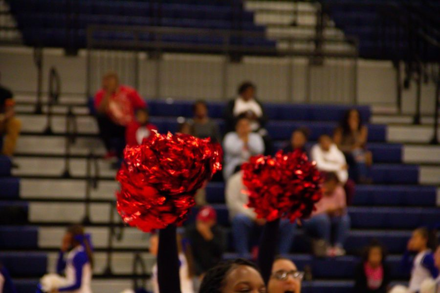 Cheerleaders+rally+on+the+audience+during+a+timeout.+