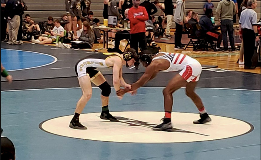 BJHS wrestler gets ready to take on opponent.