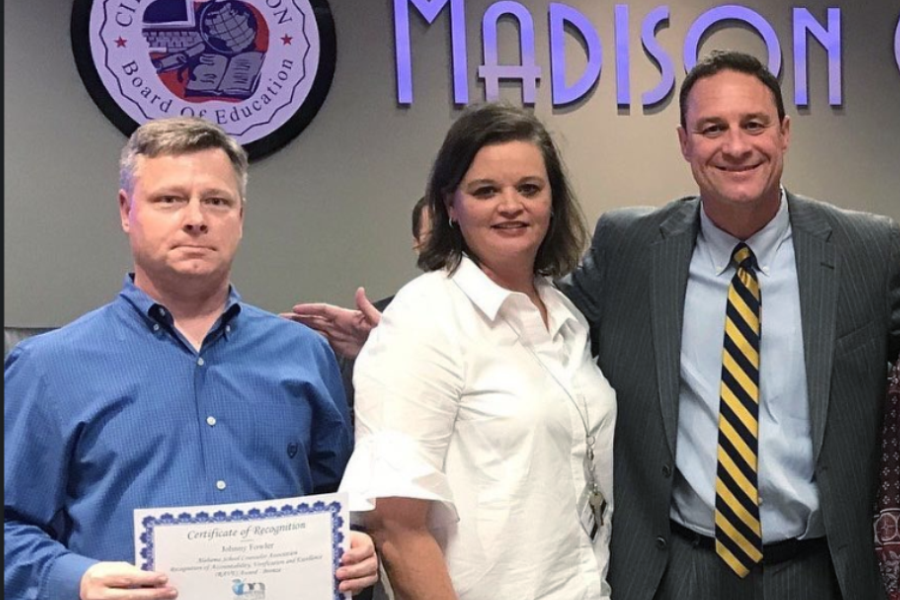 Mr. Johnny Fowler and Mrs. Sonja Griffith with Superintendent Robby Parker as they are recognized by the Board of Education for receiving the counseling RAVE award. 