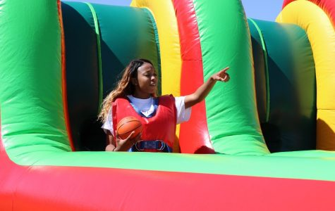 One of the many seniors playing the inflatable obstacle courses. Credit: Tiffany Wu