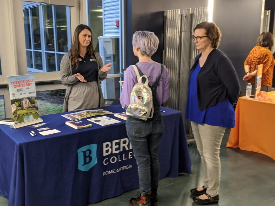Maggie Brown visits with a college rep.