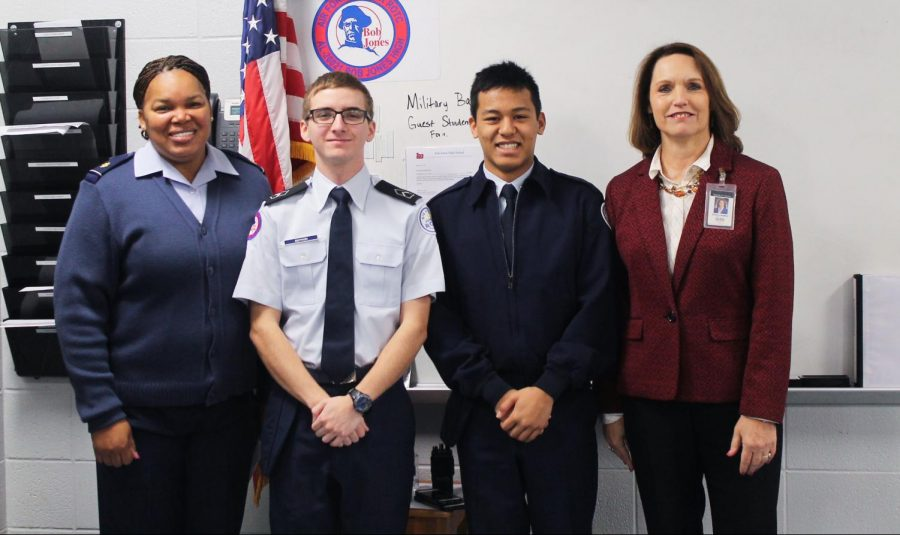 (Left to Right) Major Lacey, Nicholas Boykin, Jake Palenapa, and Ms.Lambert take a picture after receiving the scholarships.