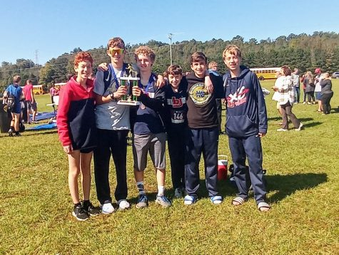 "Junior High/Junior Varsity XC: ""Run as One, Work as a Team, Finish as a Family."""